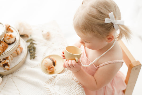 sister tea party photography idea - Belle & Kai