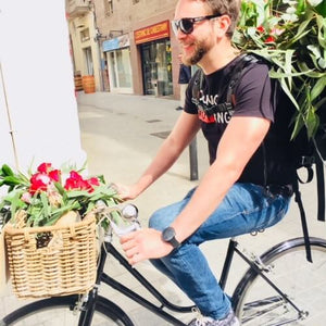 Courier on bike Sending Flowers to Barcelona