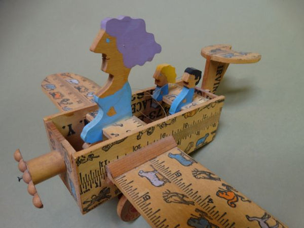 William Accorsi - Lady Piloting her Kids in an Airplane Sculpture-Toy