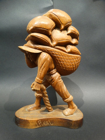 Jose Pinal (1913-1983) Woodcarving of Farmer Carrying Sacks of Grain 1930s-40s