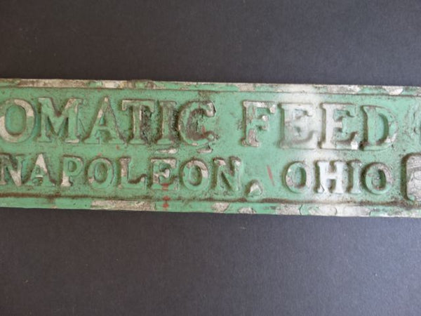 """Automatic Feed Co."" Metal Sign"