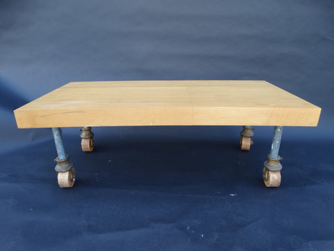 Re-Purposed Butcher Block Coffee Table with 19th Century Industrial Factory Wheels