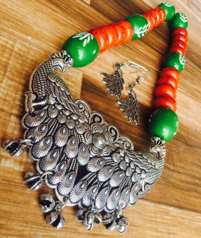 Orange Beads Set with peacock pendent