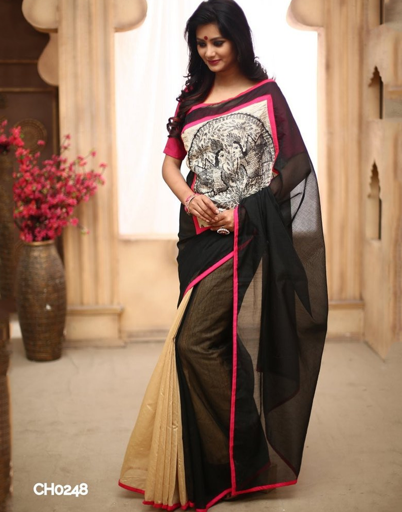 Black chanderi with hand painted madhubani work in front with beige chanderi on pleats