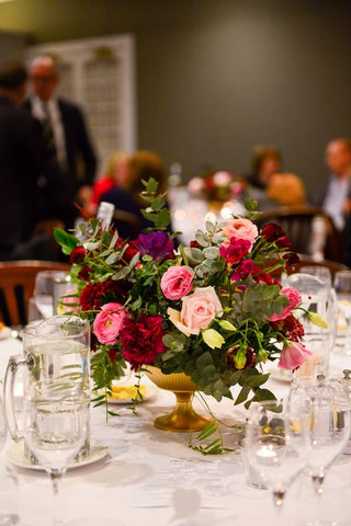 Flowers at Haberfield. Table centrepiece in an urn. Sydney wedding florist. Inner West Florist.