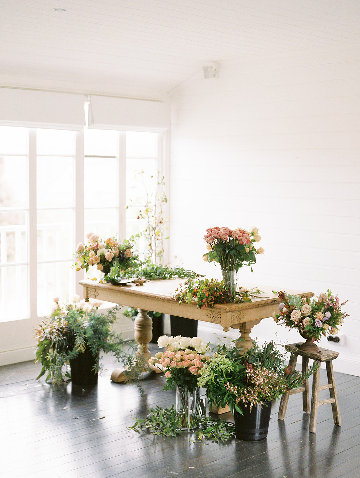 Flower arrangements in garden and romantic styling beautifully arranged on a table by Gathered Floral