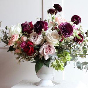 Loose, organic arrangement overflowing with the season's best blooms.