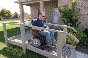 QRamp man exiting home in power wheelchair