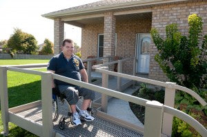 QRamp man exiting home in manual wheelchair