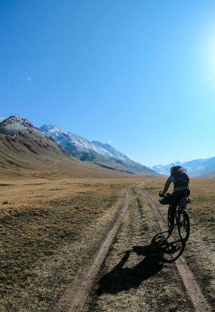 Katie cycling in Kyrgyzstan