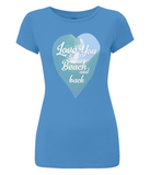 "EP04 Organic and Eco Women's T-Shirt in a bright blue slim-fit style, features a watercolour ocean wave and the quote ""Love You to the beach and back"" enclosed in a heart"