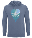 EP60P An eco and organic unisex hoodie which is a faded denim colour, there is a heart shaped design on the front with a digital art watercolour image in blues, turquoise and white, with a stylised white font reading 'Mermaid at Heart'.