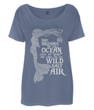 "EP46 Organic Eco Women's Oversized Mermaid T-Shirt in denim blue contains the quote ""She Dreams of the Ocean and Longs for the Wild Salt Air"""