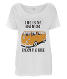 "EP46 Organic Eco Women's Oversized T-Shirt contains the quote ""Life is an adventure. Enjoy the Ride"" and features a classic VW camper van in orange."