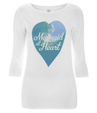 "EP07 Eco and Organic Women's 3/4 Sleeve T-Shirt features a watercolour ocean wave and the quote ""Mermaid at Heart"" enclosed together in a heart"