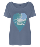 "EP46 Eco and Organic Women's Oversized denim blue T-Shirt features a watercolour ocean wave and the quote ""Mermaid at Heart"""