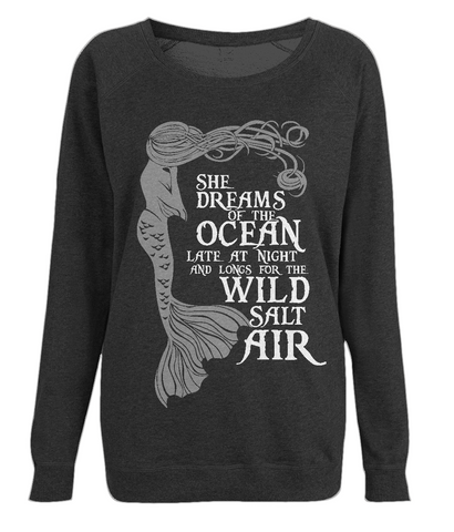 "EP66 Organic Combed Cotton Unisex Black Raglan Sweatshirt contains the emotive and mermaid inspired quote ""She Dreams of the Ocean late at night and Longs for the Wild Salt Air"""