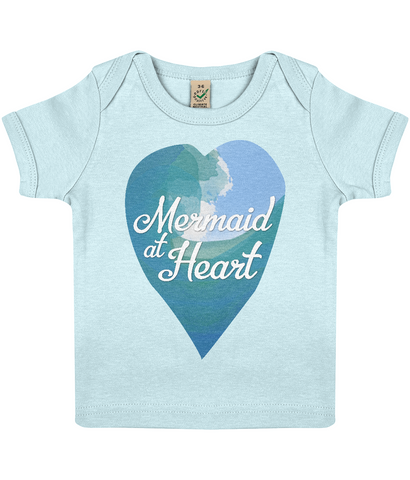 "EPB01 Organic Cotton Baby T-shirt in Soft Blue features a watercolour ocean wave and the quote ""Mermaid at Heart"" enclosed together in a heart"