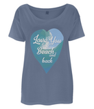 "EP46 Organic and Eco Women's Oversized denim blue T-Shirt featuring a watercolour ocean wave and the quote ""Love You to the beach and back"" enclosed together in a heart"