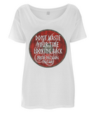 "EP46 Eco Women's Oversized white T-Shirt contains a quote set on a Viking shield ""Don't Waste Your Time Looking Back - You're not Going That Way"""