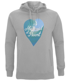 EP60P Organic and Eco unisex hoodie in a melange grey, the heart shape on the front features a watercolour ocean wave in turquoise and blue with the white font reading 'Mermaid at Heart'.