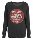 "EP66 Organic Combed Cotton, Black Raglan Sweatshirt contains an inspirational quote set on a Viking shield ""Don't Waste Your Time Looking Back - You're not Going That Way"""