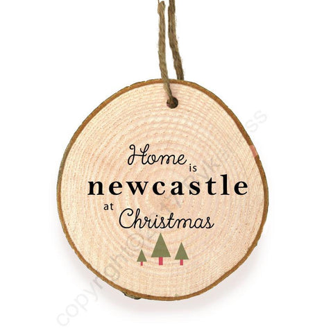 Home is Newcastle at Christmas Wooden Slice Bauble by Wotmalike