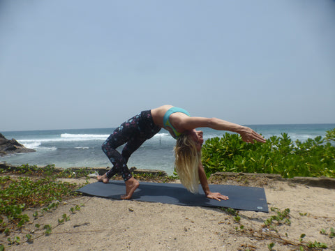 Nat practising beachside yoga