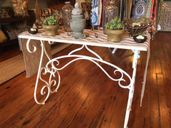 white metal scroll table