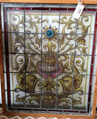 Antique stained glass window griffin urn