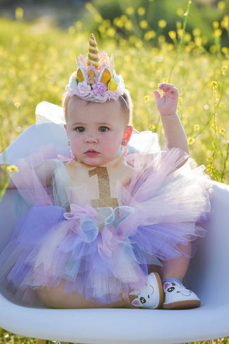 Birthday girl showstopper dress. Pastel rainbow colors! First birthdays won't be the same without the this dress!