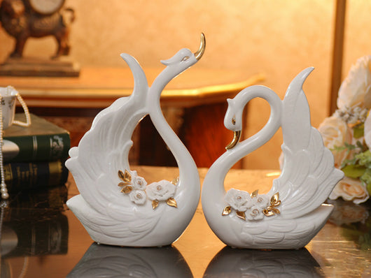 Pair Of Porcelain Swans With An Arrangement Of White Pinched Roses Samiksha S