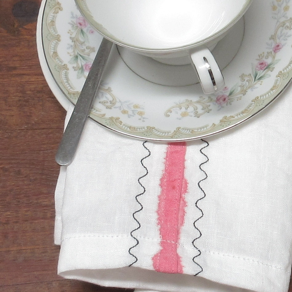 Flat-felled linen with pink stripe and embroidery