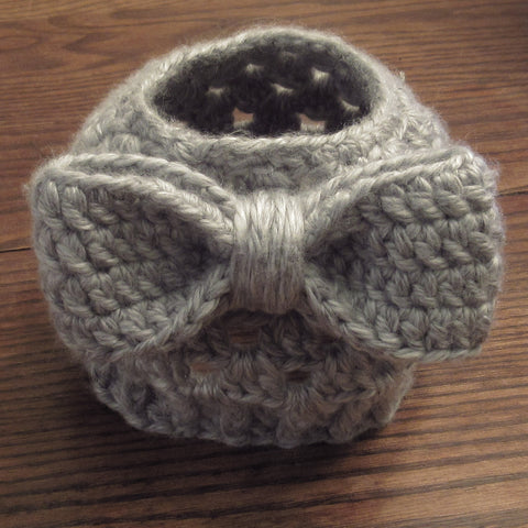 hand crocheted grey messy bun hat with bow