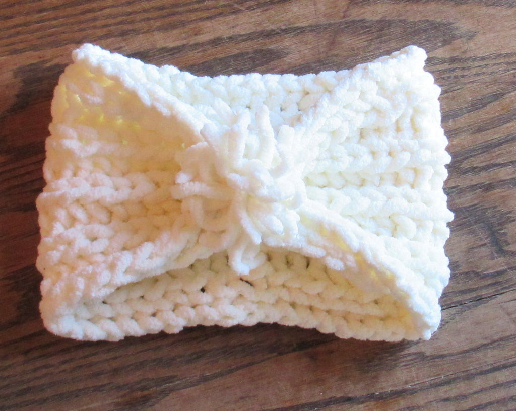 hand knitted white pom ear warmer