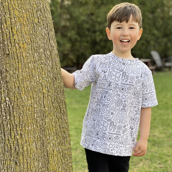 Child outside in printed t-shirt