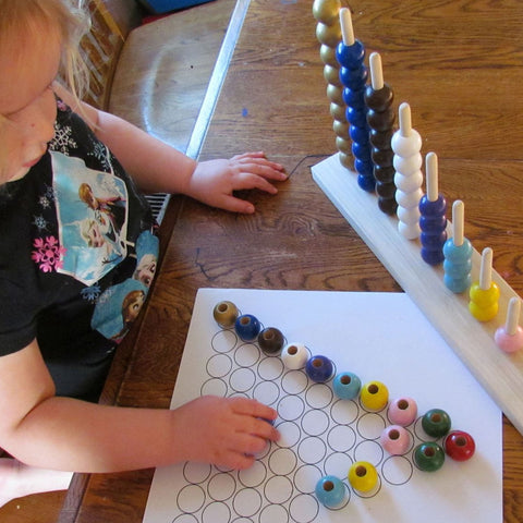 Gilr playing with MDH Toys Montessori Bead Stair Stacker