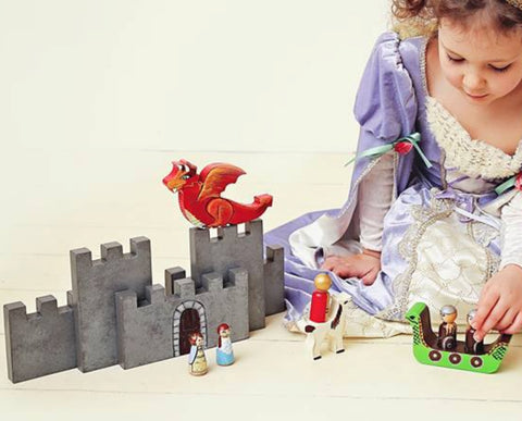 Girl playing with MDH Toys Viking Dragon Castle play set. Photo by Evie Rose Photography (Edmonton, Alberta)