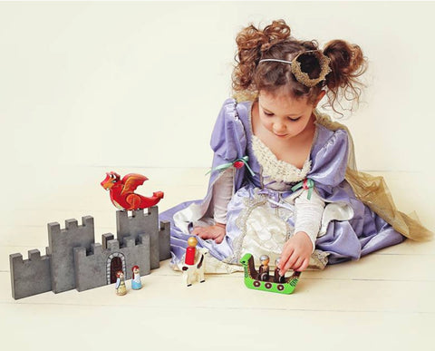 girl playing with MDH Toys Viking Dragon Castle Storybook Set. Photo by Evie Rose photography