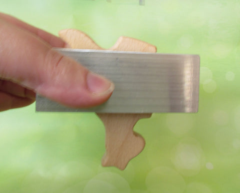 Mass produced wooden kangaroo teething toy made in Asia being put through the mandatory rattle testing device and failing the teething toy test