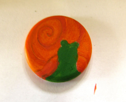 finishing the base coats of paint painted onto the wooden snail magnet in this how to paint a snail diy tutorial