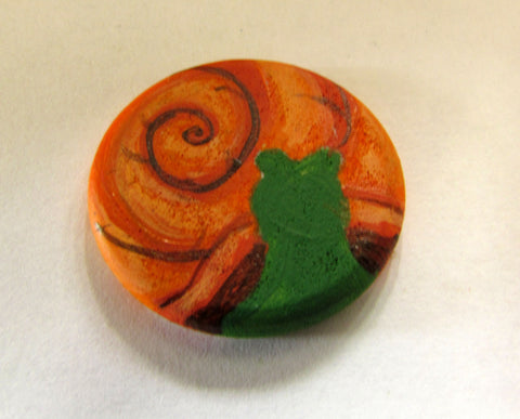 adding the shadows onto the wooden snail magnet in this how to paint a snail diy tutorial