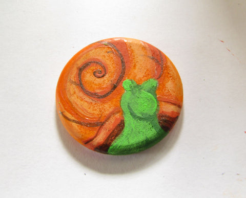adding brightness onto the wooden snail magnet in this how to paint a snail diy tutorial
