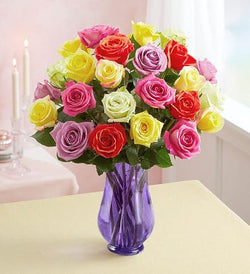 Two Dozen Roses - Assorted Colors in a Purple Vase