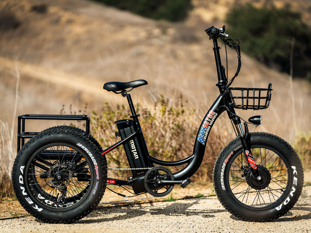 addmotor motan m-330 fat tire electric trike in outdoor setting