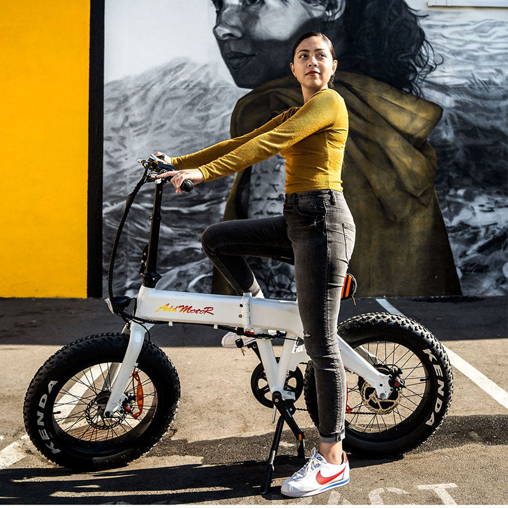 addmotor motan m-160 fat tire folding electric bike with girl riding outside
