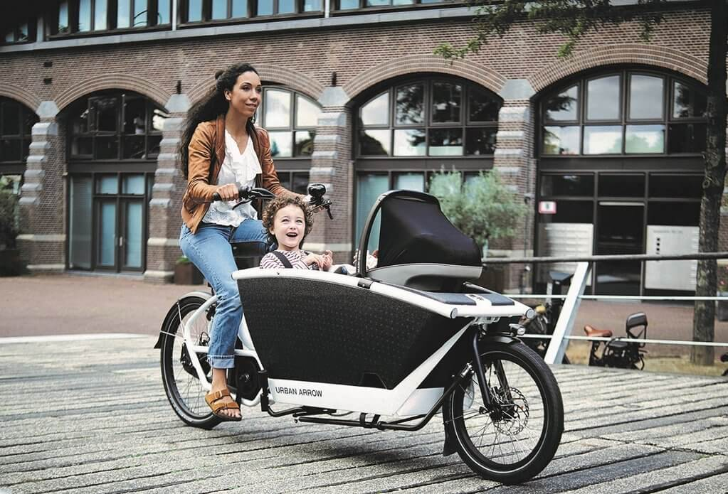 electric cargo bike with woman and child