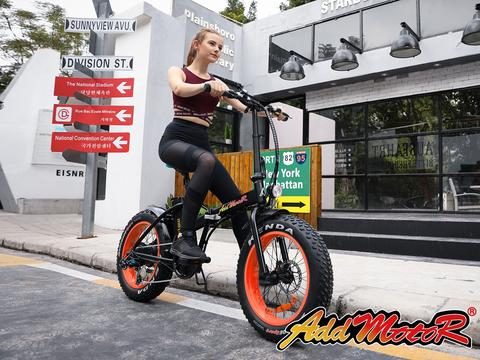 addmotor motan m-150 outside view with girl riding electric bike