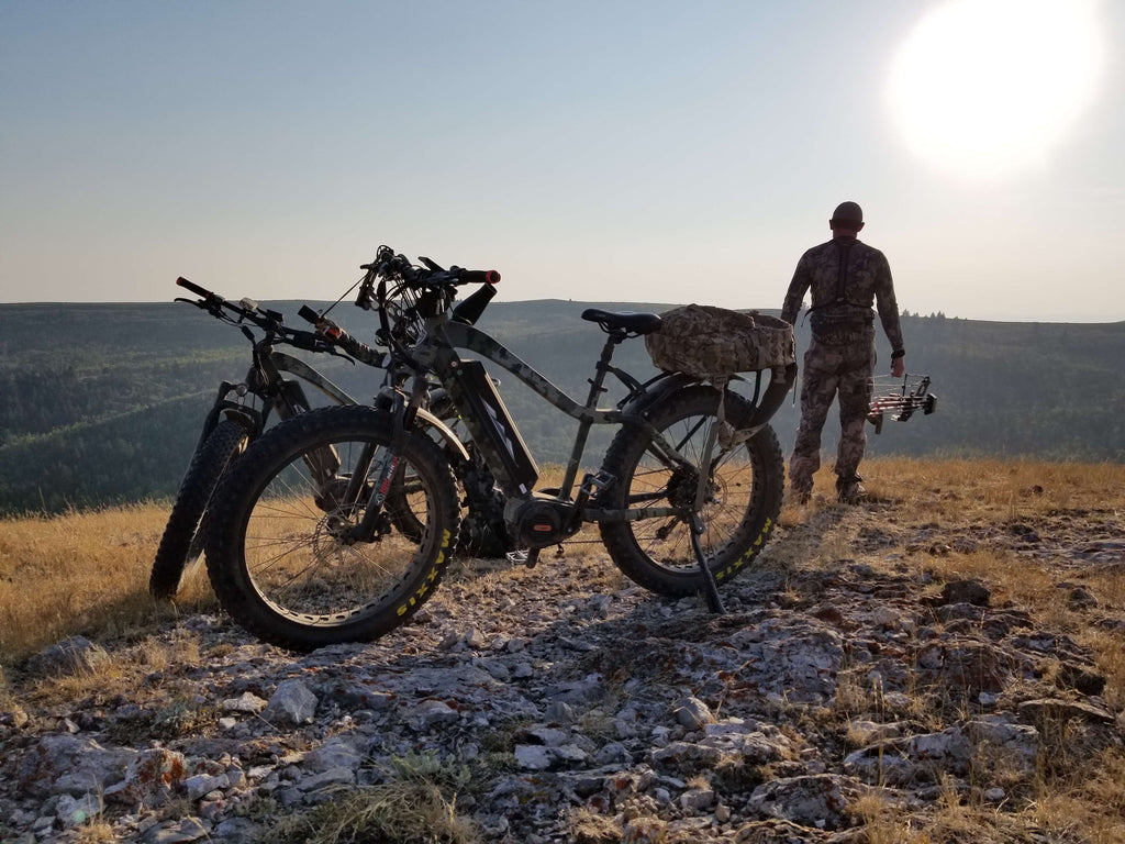 backcountry ebikes hunter outside landscape with two electric mountain bikes