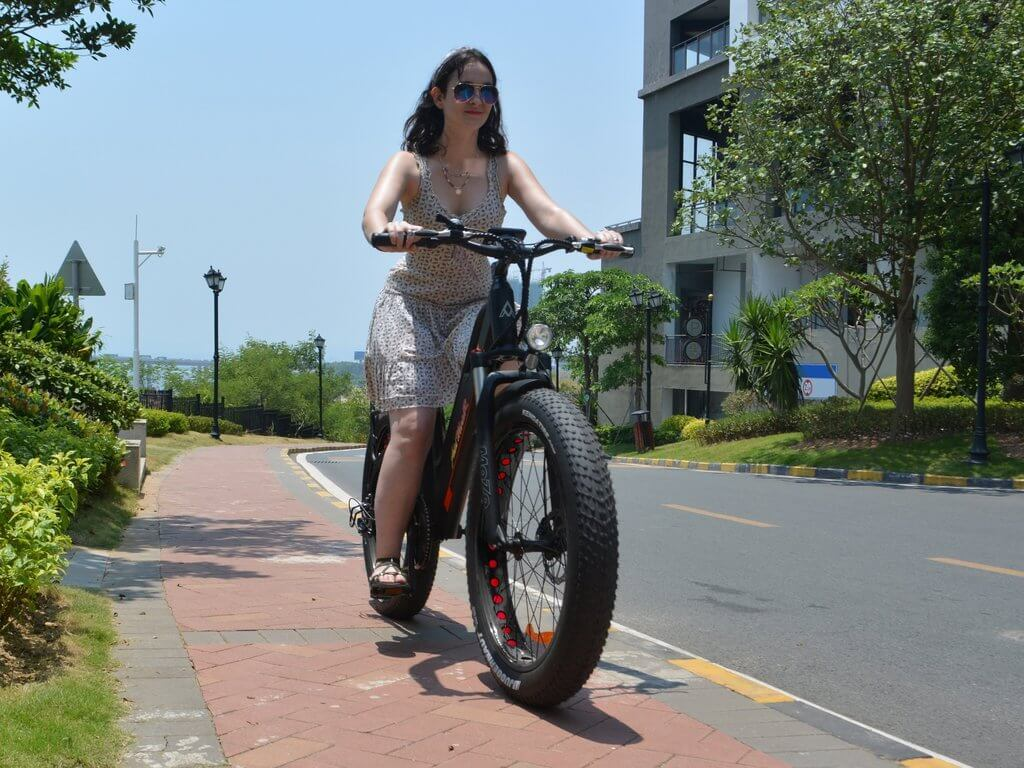 young woman commuting on a fat tire electric bike